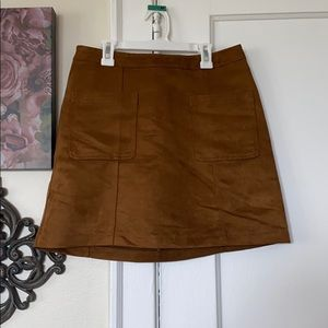 Suede tan mini skirt.